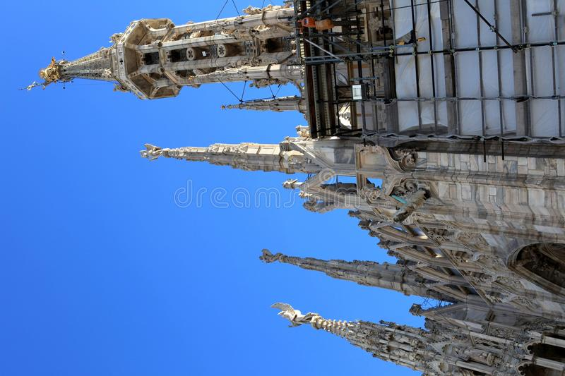 Close up of Madonnina on Duomo's roof stock images