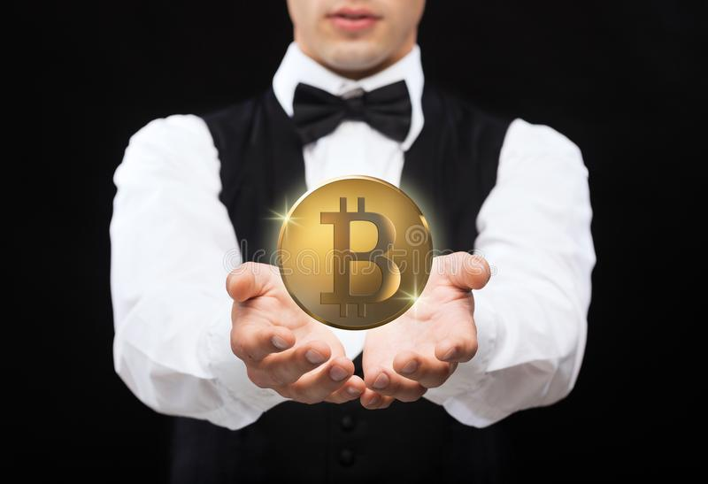 Close up of magician with bitcoin over black royalty free stock images