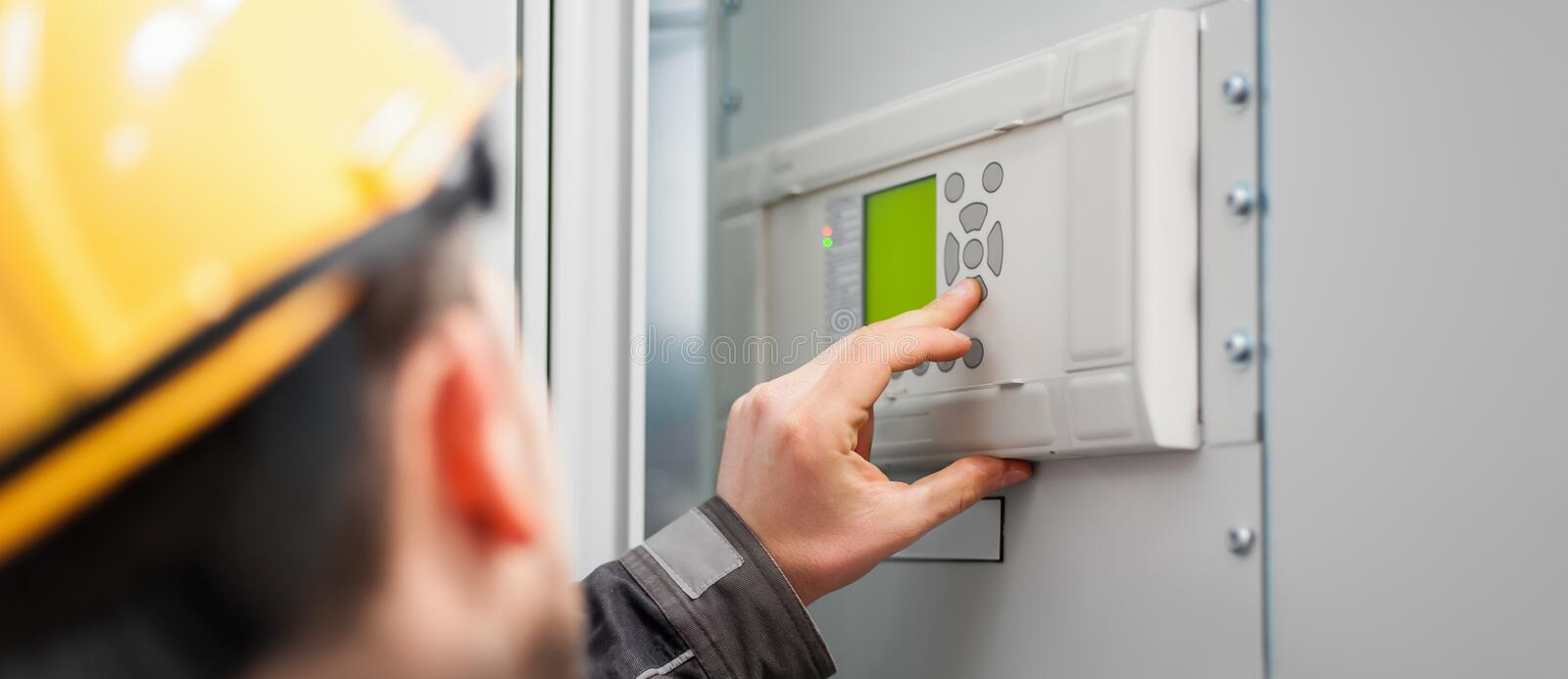 Close up of maintenance engineer testing voltage switchgear royalty free stock photos
