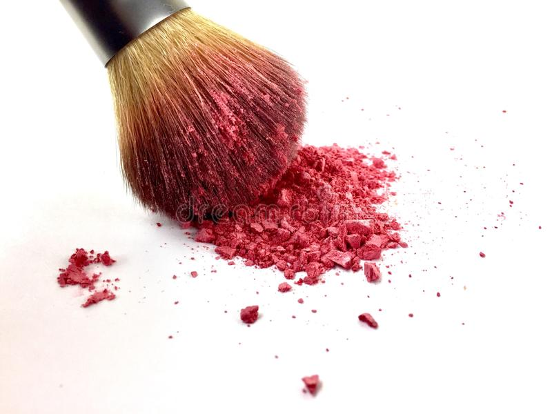 Blush brush with pink powder blush isolated on a white surface stock photos