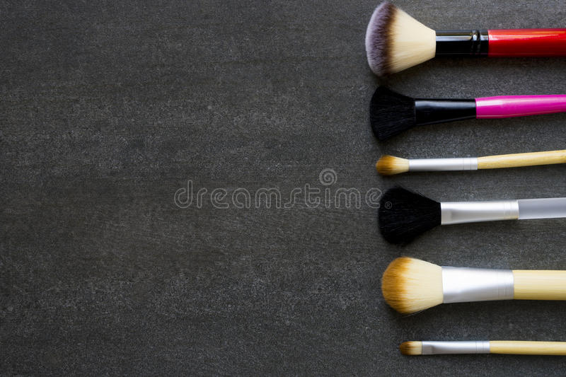 Close up of makeup brushes on black background royalty free stock photography