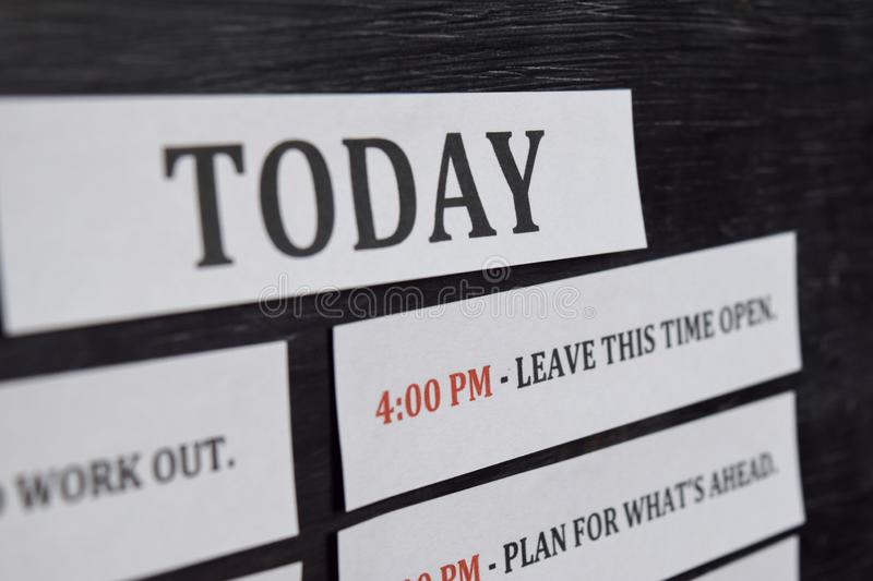 Close up making agenda Daily schedule on personal organizer. Business and entrepreneur concept. Isolated on black background stock photo