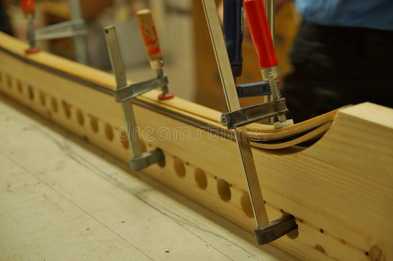 Close up of making recurved bow in workshop. bow-maker stock photography