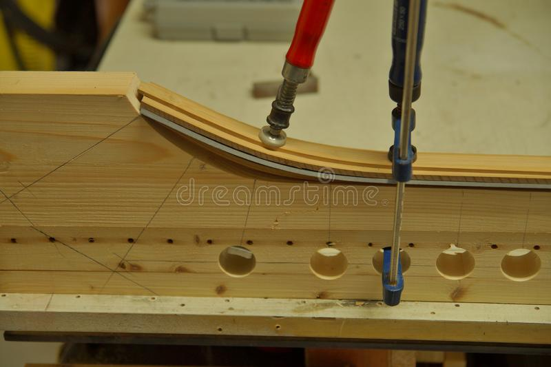Close up of making recurved bow in workshop. bow-maker stock photo
