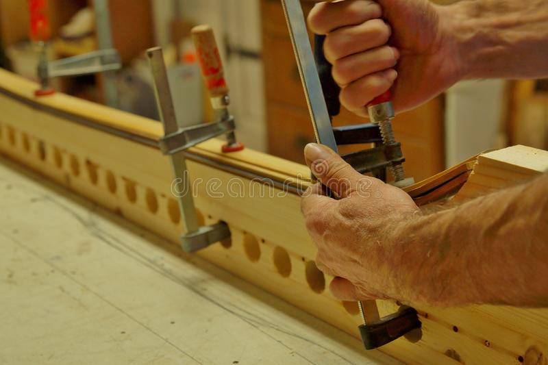 Close up of making recurved bow in workshop. male bow-maker stock photos