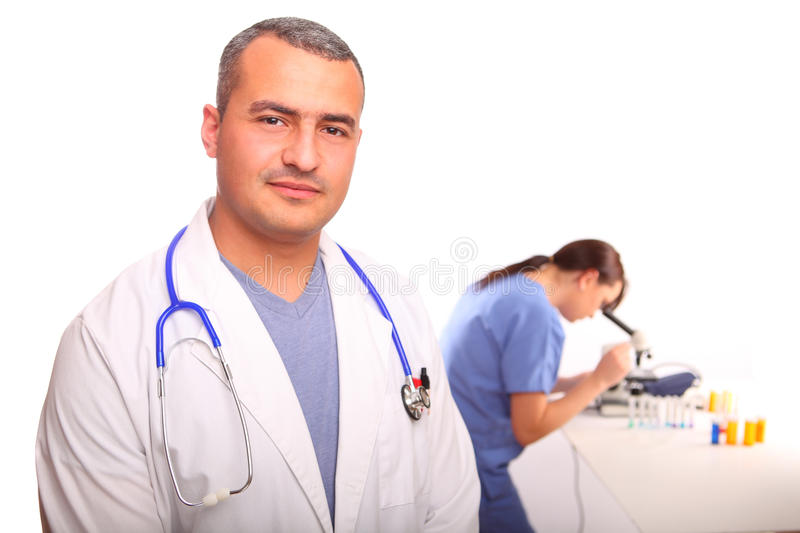 Close up of male Doctor with a female nurse. In the background looking through a microscope, isolated on white stock photo