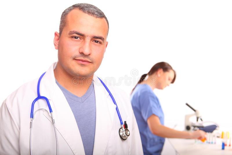 Close up of male Doctor with a female nurse. In the background looking through a microscope, isolated on white stock image