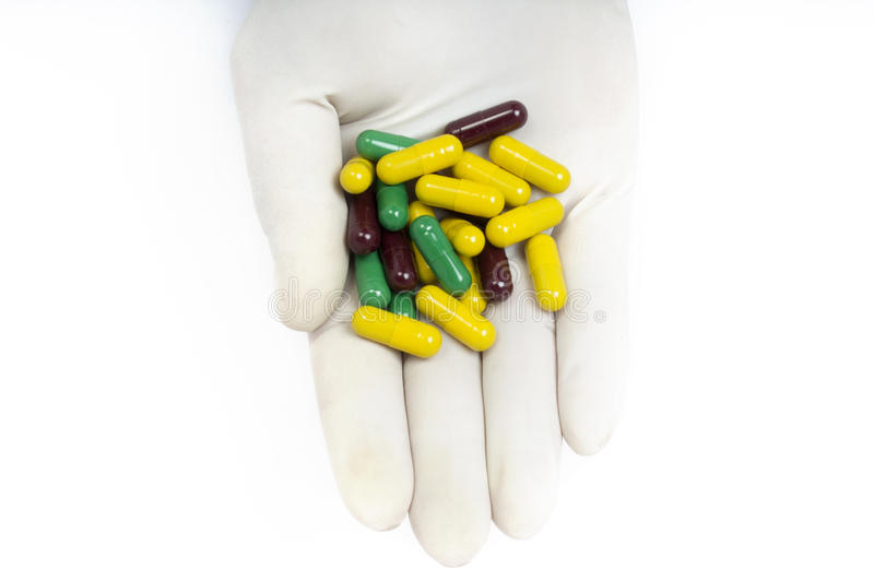 Close-up Of The Male Doctor Offering Pills capsules royalty free stock photos