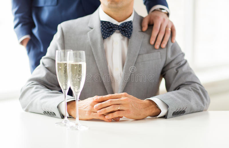 Close up of male gay couple with champagne glasses royalty free stock photos