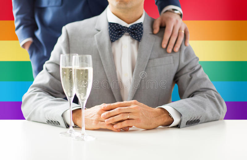 Close up of male gay couple with champagne glasses. People, celebration, homosexuality, same-sex marriage and love concept - close up of happy married male gay stock photos