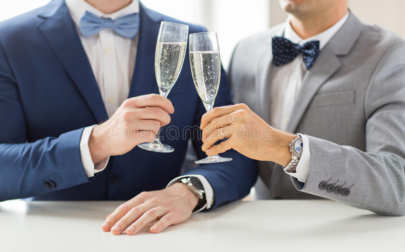 Close up of male gay couple with champagne glasses. People, celebration, homosexuality, same-sex marriage and love concept - close up of happy married male gay stock images