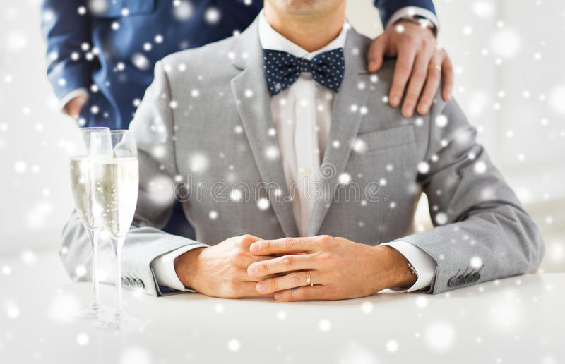 Close up of male gay couple with champagne glasses. People, celebration, homosexuality, same-sex marriage and love concept - close up of married male gay couple stock photo