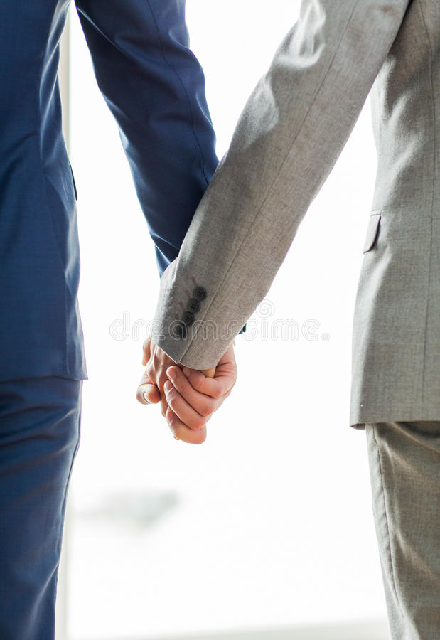 Close up of male gay couple holding hands royalty free stock photography