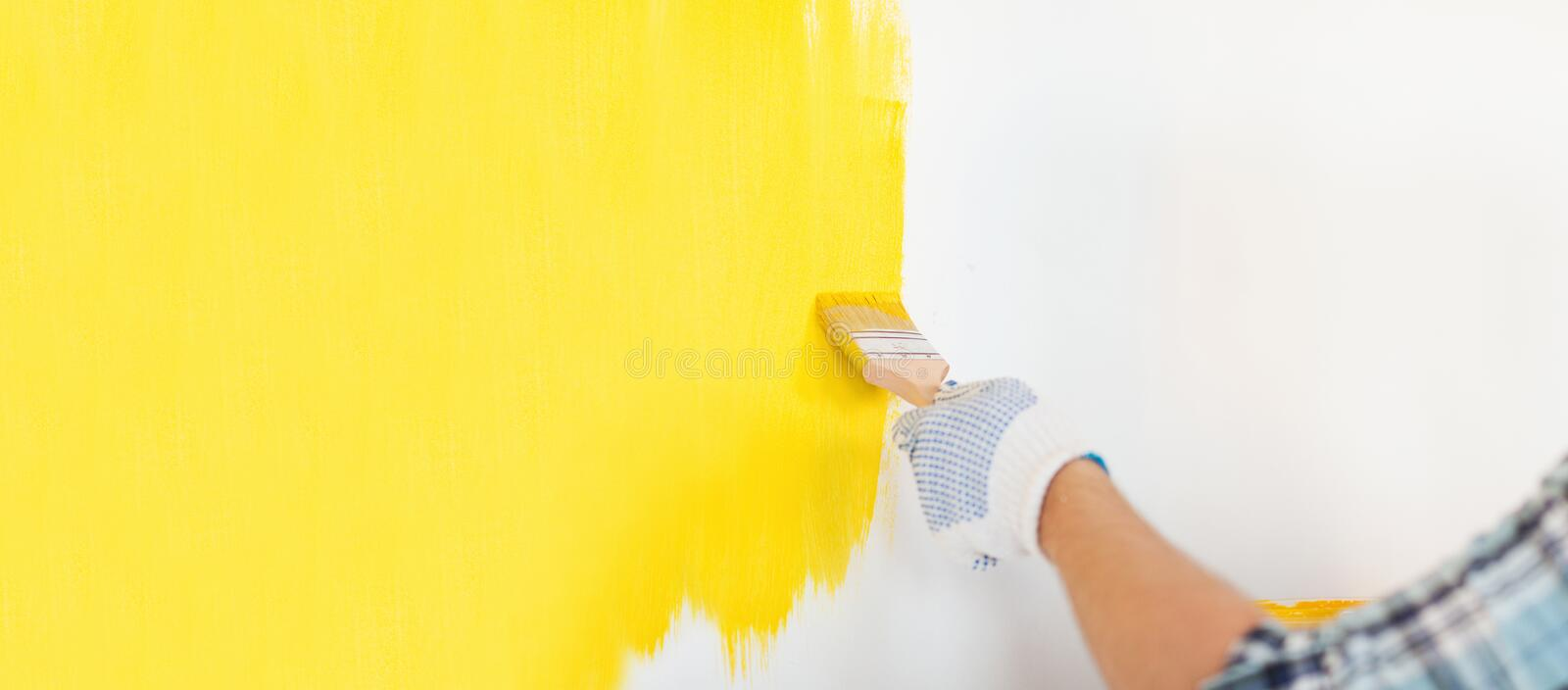 Close Up Of Male In Gloves Painting A Wall Stock Image - Image of ...