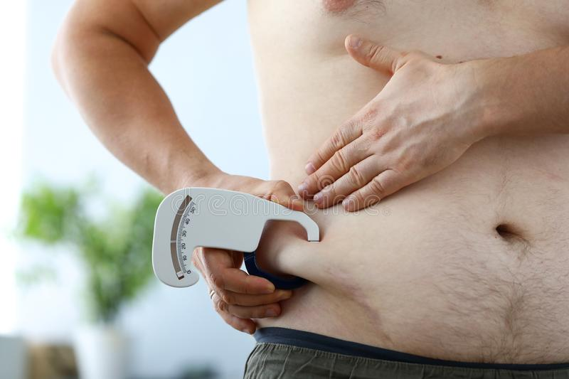 Measuring obese belly royalty free stock images