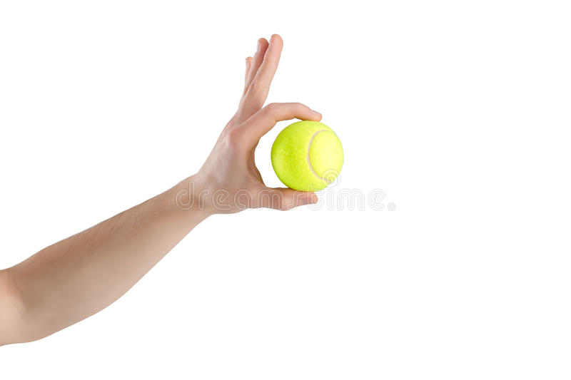 Close-up of male hand holding tennis ball on white background stock images