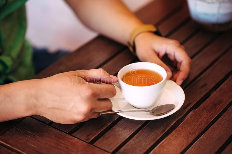 Close-up male hands holding a cup of tea. stock image