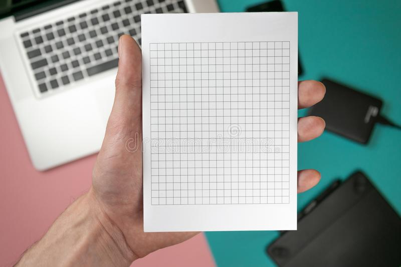 Close up male hands holding paper blank for design paper royalty free stock images