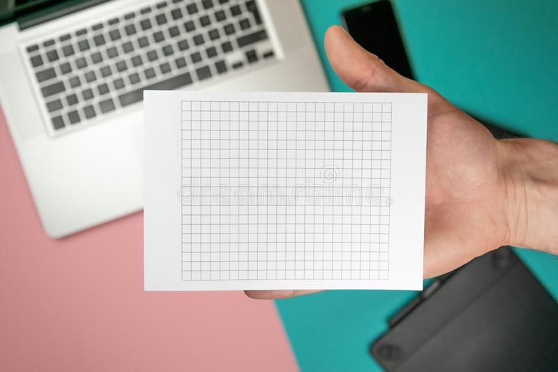 Close up male hands holding paper blank for design paper royalty free stock photo