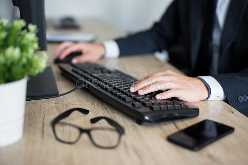Close up of male hands on keyboard stock image