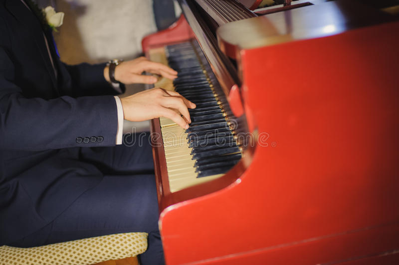 Close up of male hands playing piano. Horizontal shape, copy space stock photography