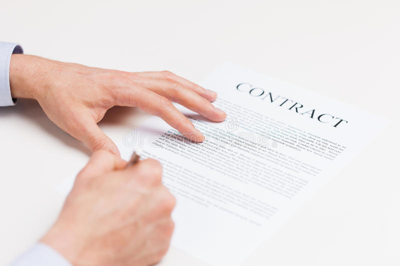 Close Up Of Male Hands Signing Contract Document Stock Photo