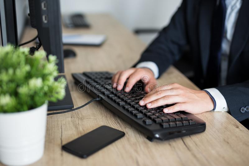 Close up of male hands using computer royalty free stock images