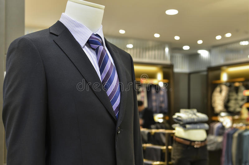 Close up of male mannequin in clothing shop. Close up of man mannequin in fashion shop,Hongkong,China,Asia. navy Blue business suit,thin white stripe shirt stock image