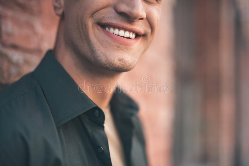 Close up of male smile with teeth revealed royalty free stock photo