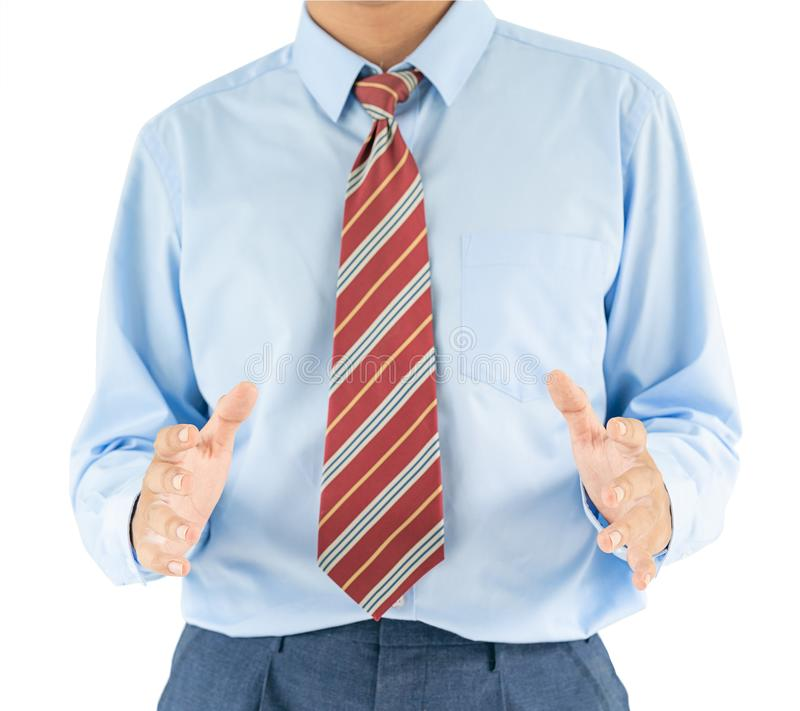 Male wearing blue shirt reaching hand out with clipping path. Close up, Male wearing blue shirt and red tie reaching hand out with clipping path royalty free stock images