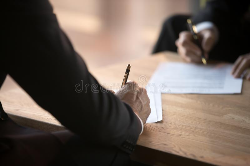 Close up of business partners sign contract at meeting royalty free stock photography
