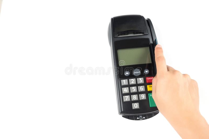 Close up man's hand swiping credit card with credit card machine for shopping payment isolated on white background. Close up man's hand holding royalty free stock photography