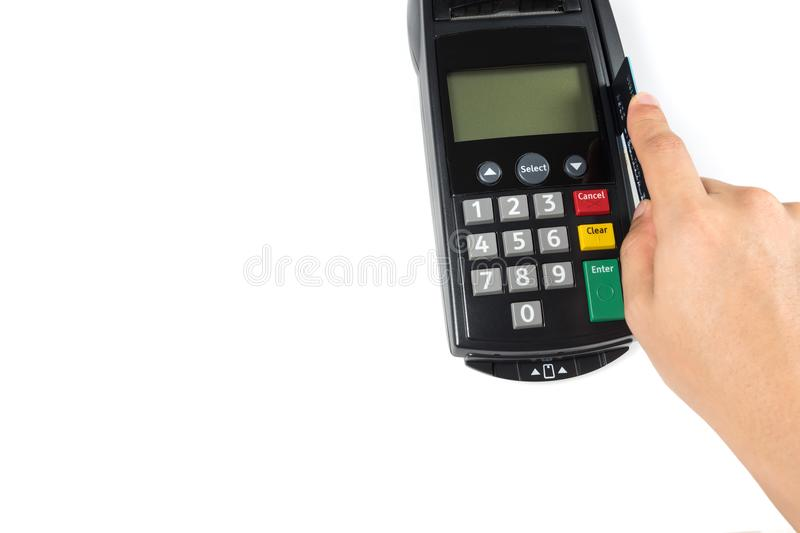 Close up man's hand swiping credit card with credit card machine for shopping payment isolated on white background. Close up man's hand holding stock image