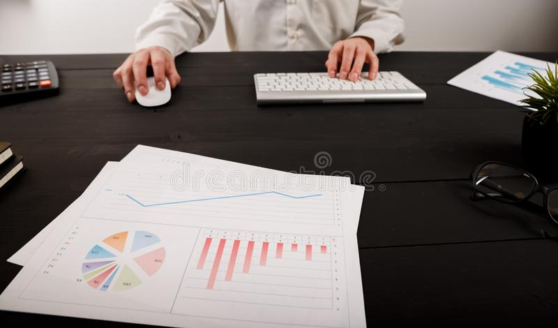 Close up of man accountant or banker making calculations. Savings, finances and economy concept stock photo
