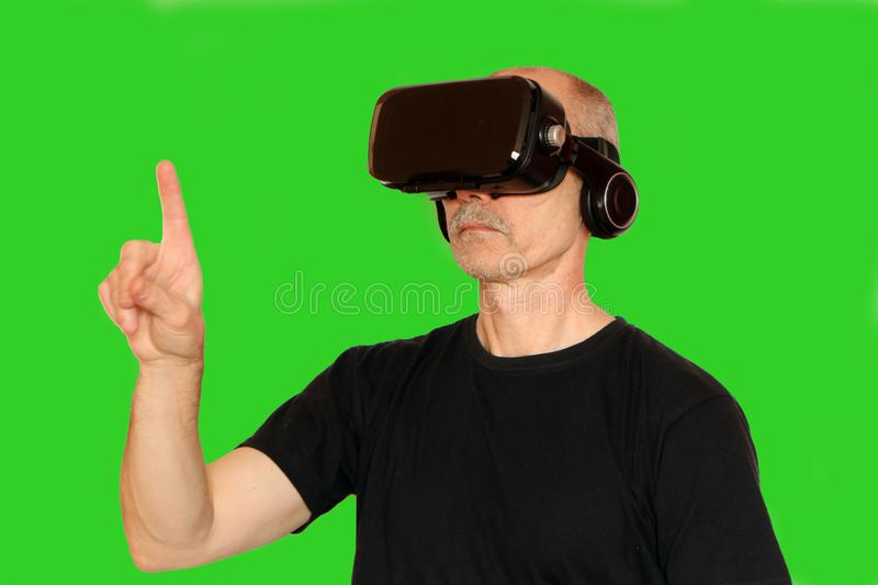 Close-up of a man in a black T-shirt with glasses of virtual reality stock images