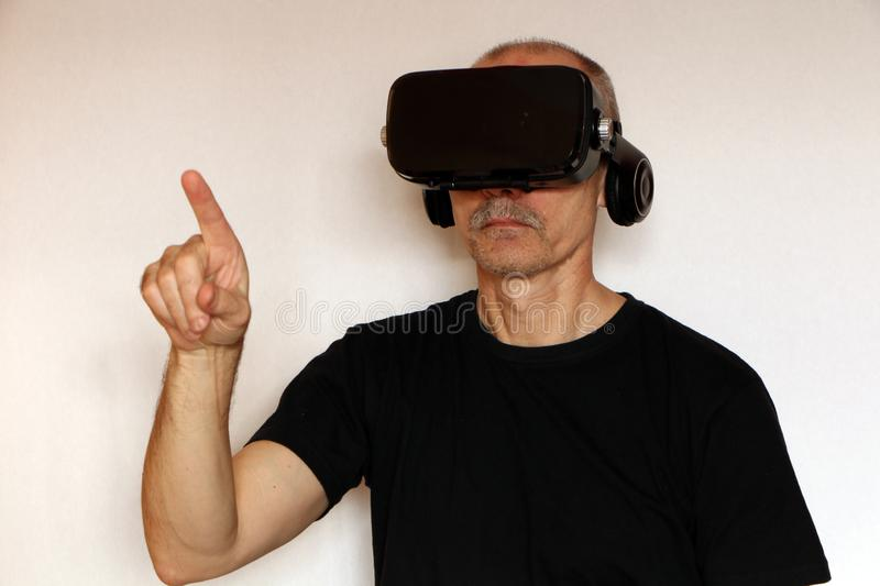 Close-up of a man in a black T-shirt with glasses of virtual reality royalty free stock photos