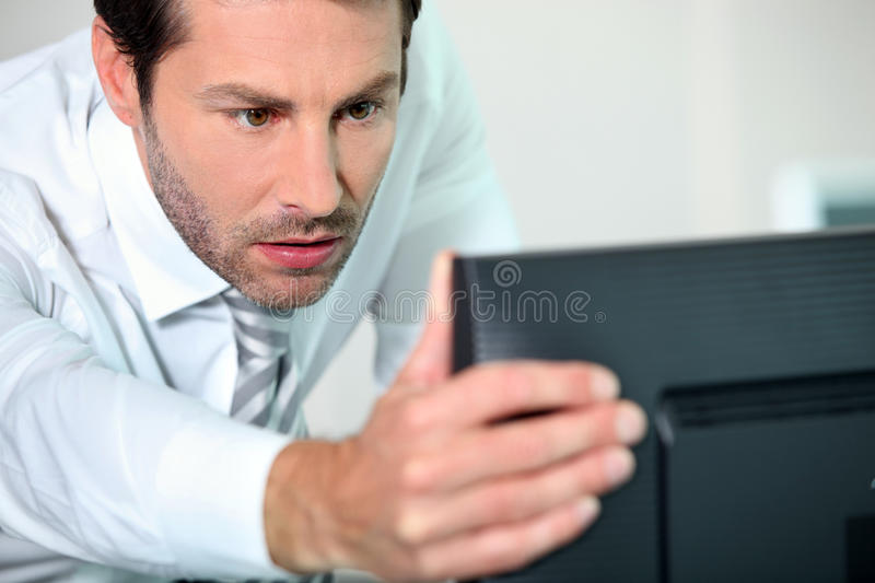Close-up of a man with computer stock photography