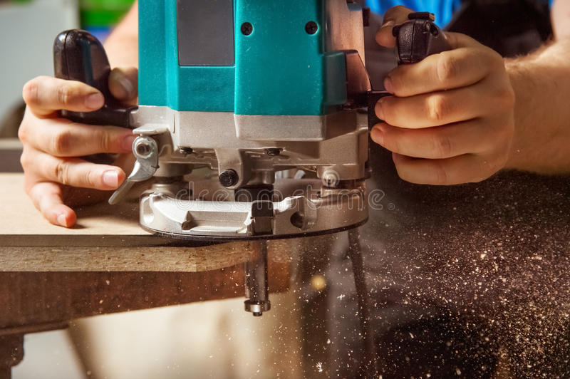 Close up Man doing woodwork in carpentry. Close up The carpenter`s man works as a hand mill stock images