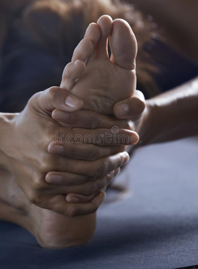 Close-up of the man doing yoga stretching exercise stock photos
