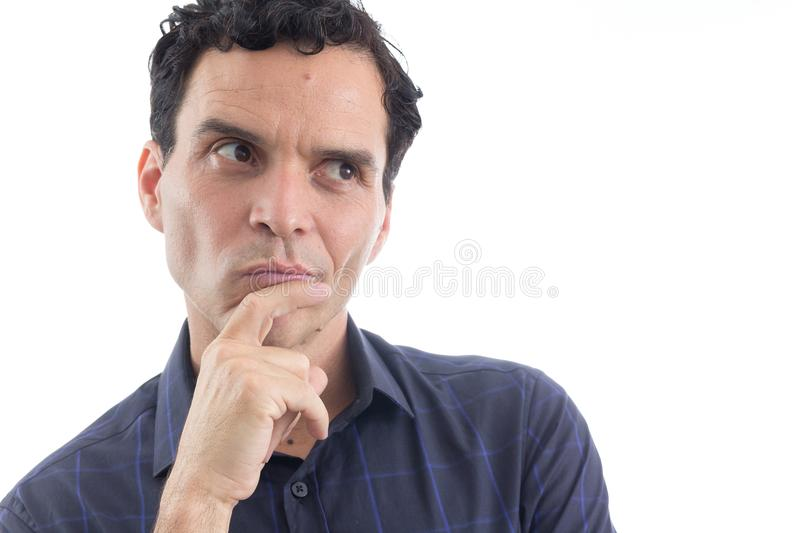 Close up of man with doubt. The person is wearing dark blue social shirt. Isolated.. royalty free stock photography