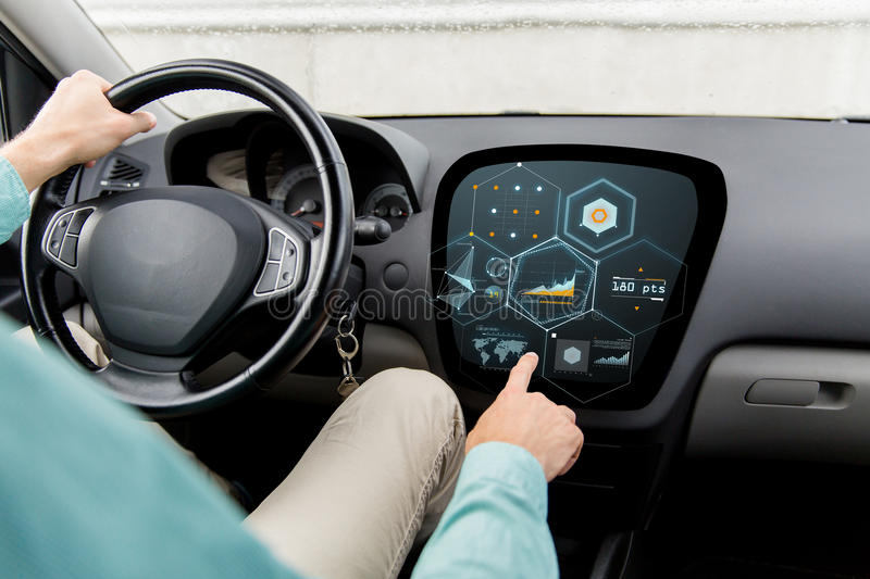 Close up of man driving car with diagram on screen. Transport, modern technology and people concept - close up of man driving car and pointing finger to diagram stock photography