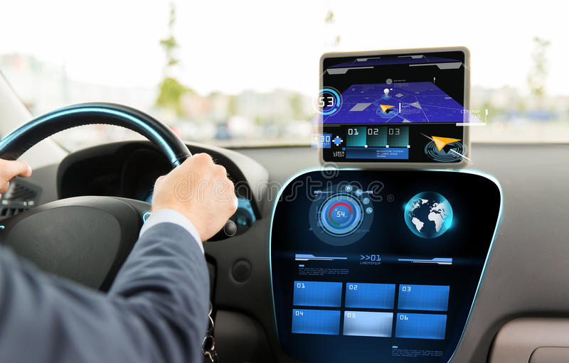 Close up of man driving car with navigation system stock images