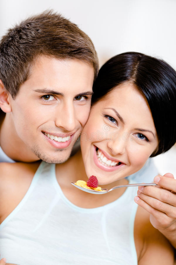Close Up Of Man Feeding His Girlfriend Stock Photography