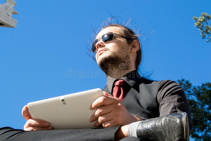Close up of a man with glasses and tablet royalty free stock photography