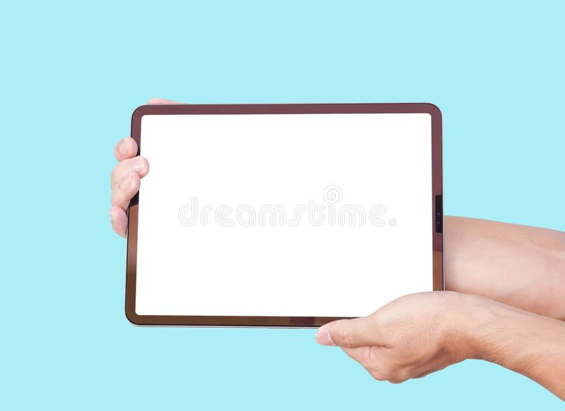 Close up man hand holding digital tablet computer with white screen for text or product advertising concept stock image