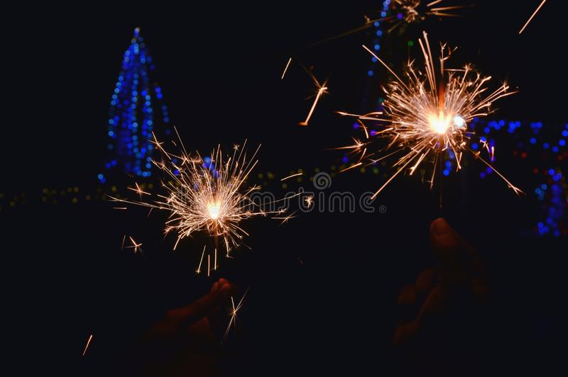 Close up of man hands holding sparkler,diwali lighting,festival  hand firework,diwali,fireworks that are brightly lit stock photos