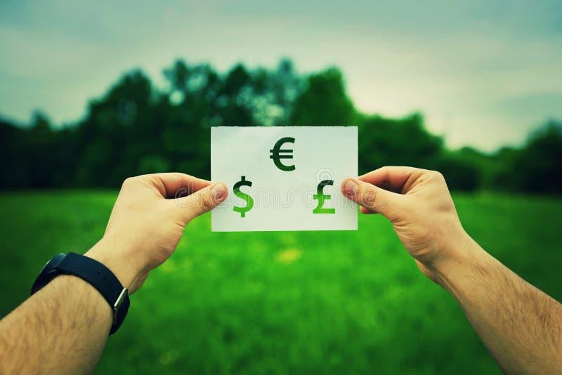 Holding money symbol stock photos