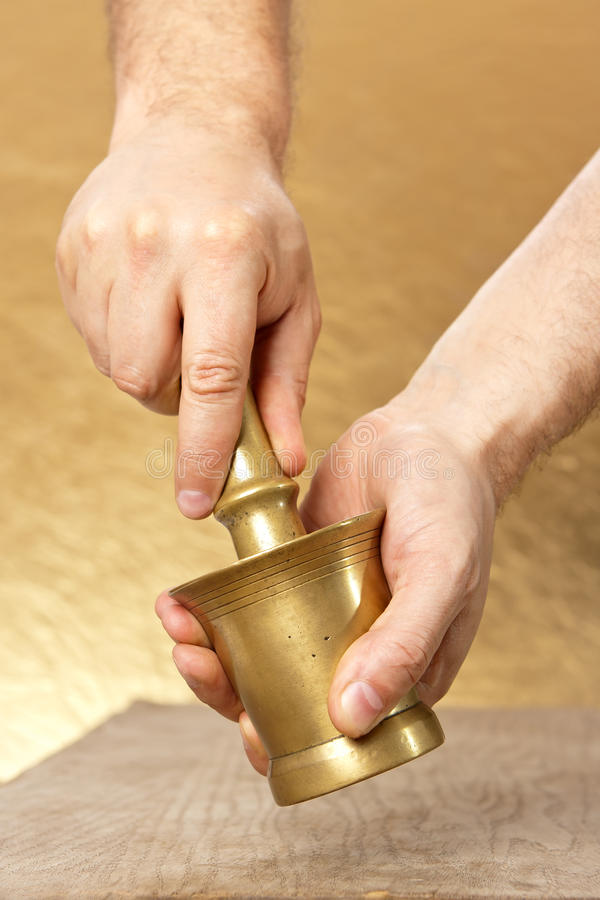 Download Close Up Of Man Hands With Mortar And Pestle Royalty Free Stock Image - Image: 26534496