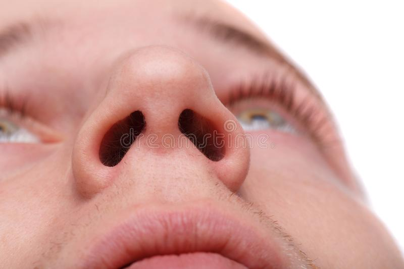 Close-up of a man showing his nostrils. Isolated over white background royalty free stock photo