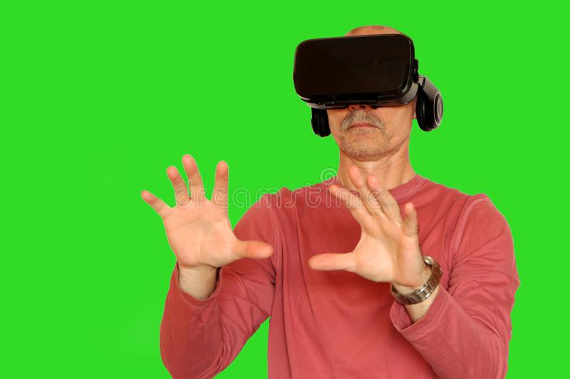 Close-up of a man in a pink T-shirt with glasses of virtual reality royalty free stock photos